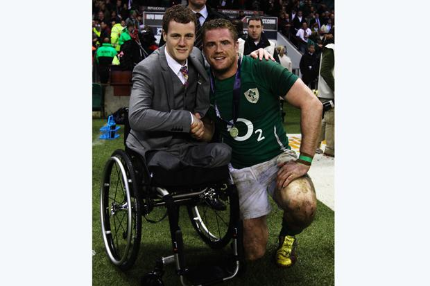 Michael is pictured with rugby player Jamie Heaslip