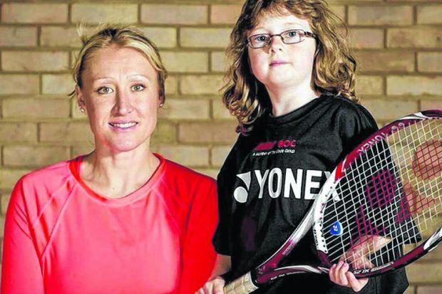 Elena Baltacha, who is battling liver cancer, with a student from her tennis academy in Ipswich