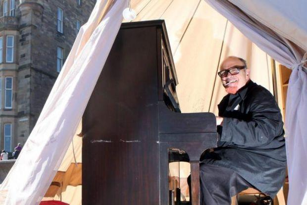ART?: Ben Treuhaft with piano on Portobello beach in Edinburgh, over which the council has threatened court action.
