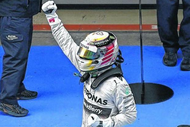 Mercedes driver Lewis Hamilton celebrates his win after leading from pole to finish in the Chinese F1 Grand Prix at the Shanghai International Circuit. Picture: Aly Song/Reuters