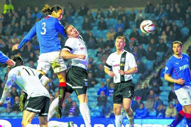 Bilel Mohsni leaps high above the Ayr United defence to plant a header from Fraser Aird's corner past David Hutton just after half-time. Picture: SNS