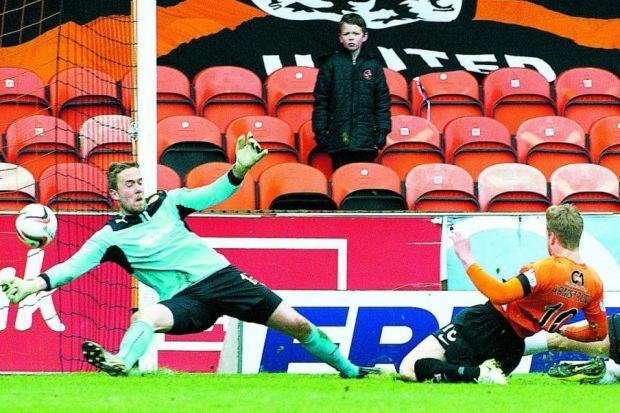 Dundee United's Stuart Armstrong makes it 3-0 despite Gunnar Nielsen getting a glove to the ballPhotograph: SNS
