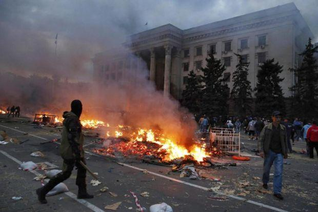 The burning remains of the camp of a group of pro-Russian protesters                      outside the trade union building in Odessa, where deadly violence erupted over the weekendPhotograph: Reuters