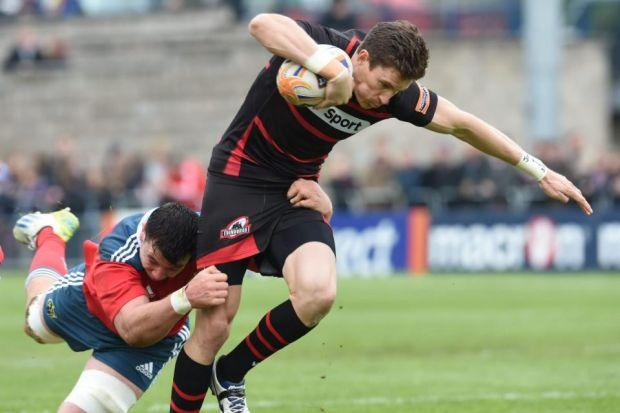 Paddy Butler of Munster grapples with Edinburgh's opening try scorer Carl Bezuidenhout Photograph: SNS