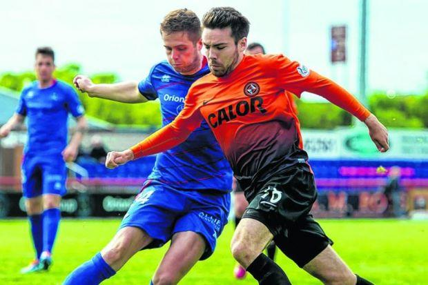 Inverness Caledonian Thistle's Danny Devine beats Ryan Dow of Dundee United to the ball. Picture: SNS