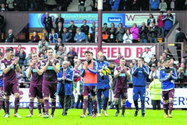 Hearts players applaud their supporters at full-time after routing Kilmarnock 5-0 at Tynecastle. Picture: SNS