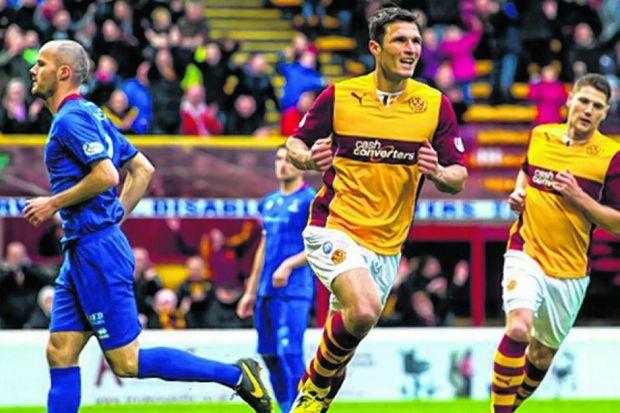 John Sutton wheels away to celebrate scoring for Motherwell. Picture: SNS