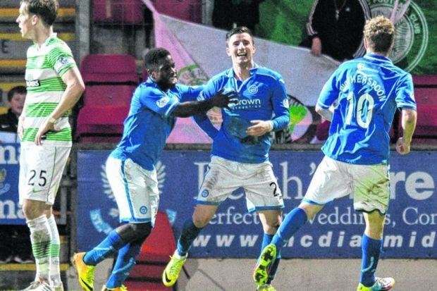 Michael O'Halloran is joined by Nigel Hasselbaink,left, and David Wotherspoon in celebration of his late equaliser at McDiarmid Park last night. Picture: SNS