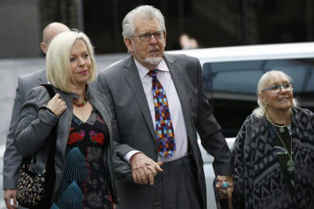 INDECENCY ALLEGATIONS: Entertainer Rolf Harris arrives at a London court with his daughter Bindi, left, and wife Alwen Hughes. Picture: Reuters
