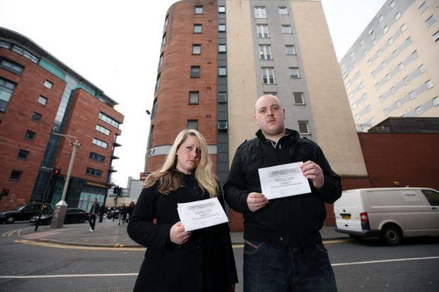 DISMAYED: Amy Brown and Gary McKay outside their flats.