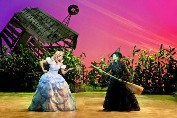Emily Tierney and Nikki Davis-Jomes are in starring roles in Wicked, which earned a standing ovation for its talented cast, wonderful costumes and dragon