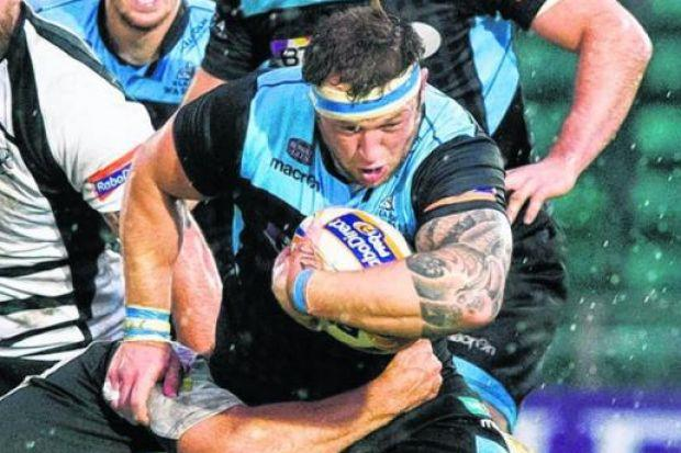 Ryan Grant drives through Zebre's defence on a night when Glasgow's relentless pressure led to a season-ending bonus point and an emphatic 54-point victory. Picture: SNS