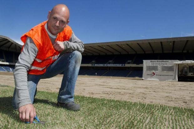 GRASS MASTER: The new partly artificial pitch has to be carefully tended by stadium staff but should recover better from the impact of big games. Pictures: SNS