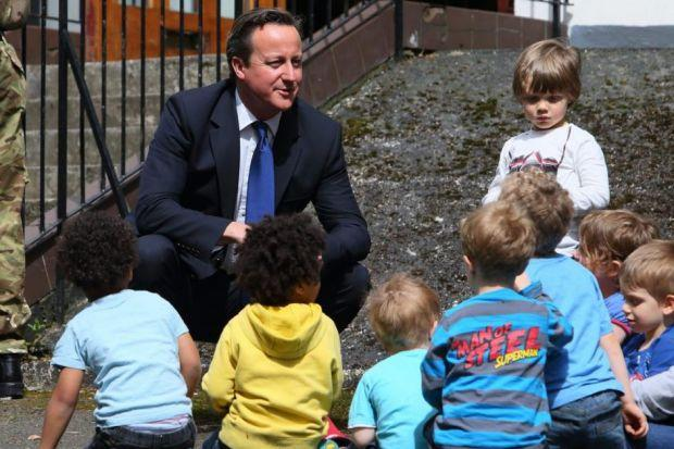 HEARTS AND MINDS: David Cameron chats to nursery children in Glasgow, where he visited to campaign for a No vote in September's referendum. Picture: Colin Mearns