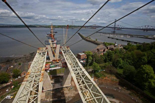 REACHING NEW HEIGHTS: The new Queensferry Crossing is advancing across the land to the water's edge. Pictures: Gordon Terris