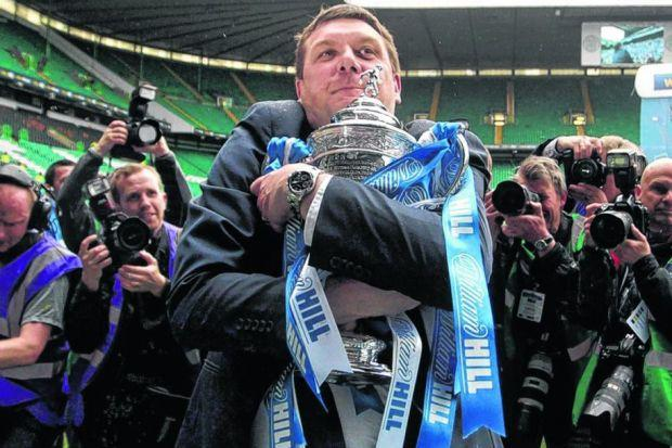 Manager Tommy Wright clutches the Scottish Cup after St Johnstone's 2-0 win over Dundee United at Celtic Park. Picture: Stewart Attwood
