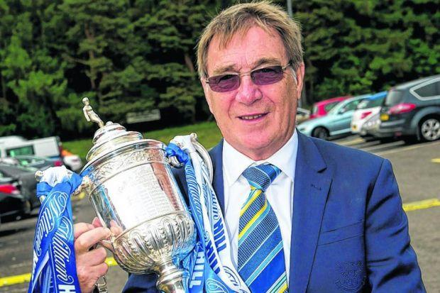 patience pays off: Former St Johnstone chairman Geoff Brown shows off the William Hill Scottish Cup. Picture: SNS