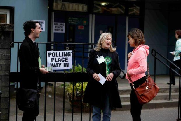 POLL POSITION: Green Party activists talk to voters outside the polling station at the Gaelic School in Berkeley Street, Glasgow. Picture: Martin Shields