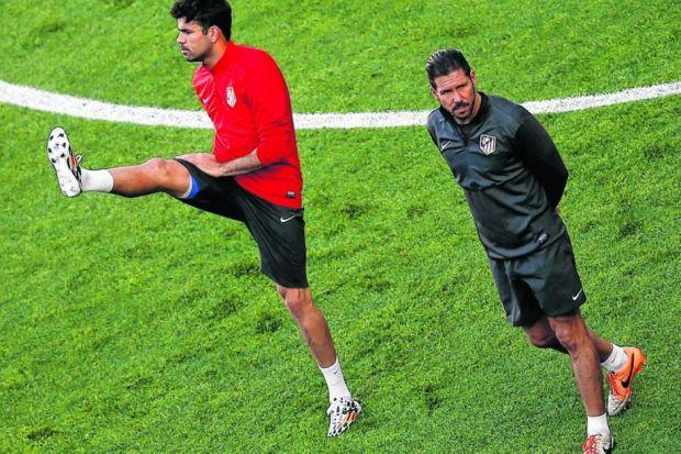 Atletico striker Diego Costa, left, returned to training after damaging his hamstring and may start up front for Diego Simeone's side. Picture: Reuters