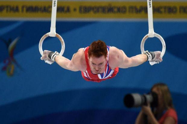 Daniel Purvis performs on the rings in Sofia