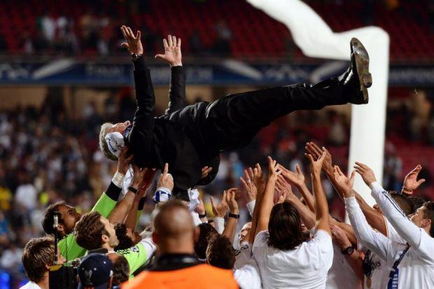 launch party: Carlo Ancelotti, the victorious coach, is sent skyward by his celebrating players. Picture: EPA