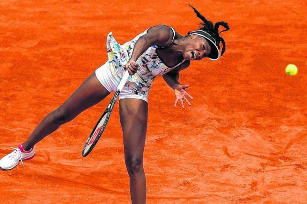 Venus Williams serves on her way to victory over the Swiss Belinda Bencic. Picture: Matthew Stockman/Getty Images
