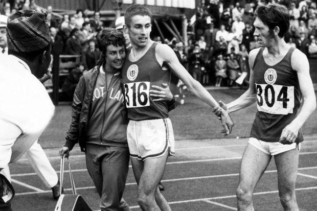 Ian Stewart is embraced by his wife Rosemary following his victory in the 5000m at Meadowbank. while Ian McCafferty, right, adds his congratulations.  Picture: James Thomson