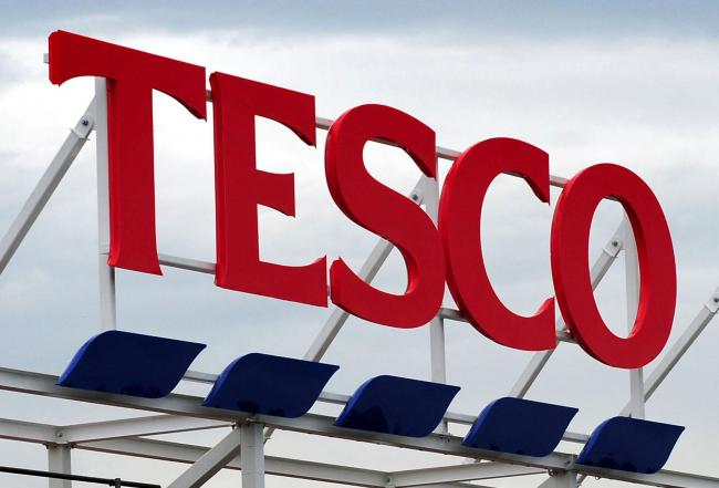 Tesco issues another profit warning, cuts dividend by 75%
