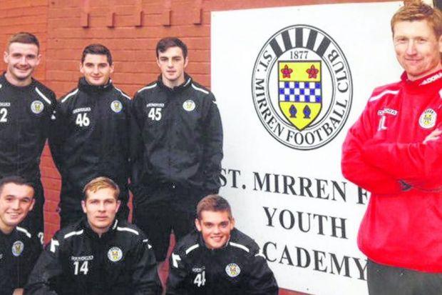 David Longwell, St Mirren's head of youth coaching, with some of the young players the Paisley club have been developing in recent years. Picture: Keith Campbell