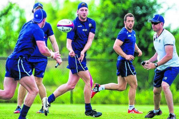 Greig Laidlaw, in the background, keeps a close eye on Finn Russell, who will make his debut in Houston. Picture: SNS Group/SRU