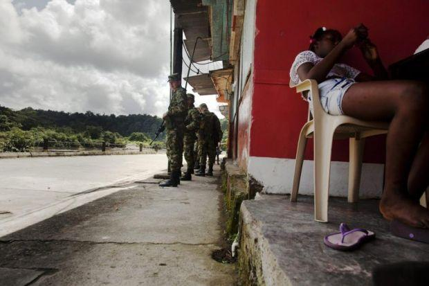 Right: Fachi Escobar has suffered more than most during Colombia's conflictMain: Colombia government troops patrol a disputed areaPhotographs: Simon Murphy and David Pratt