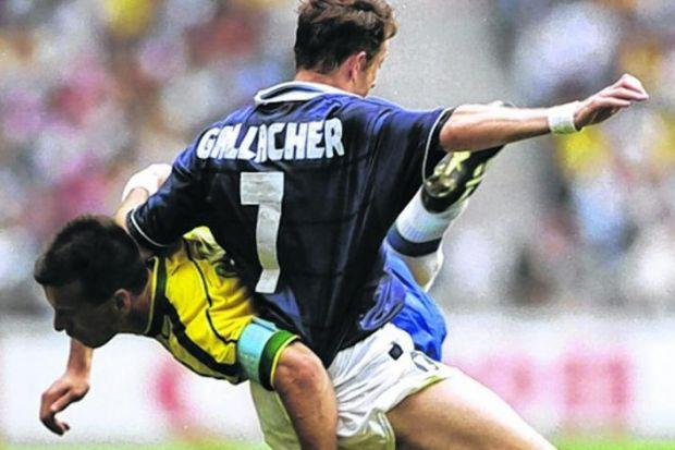 Kevin Gallacher tangles with Brazil captain Dunga