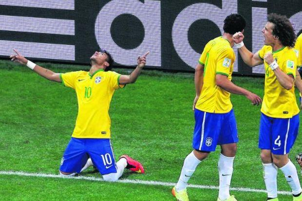 Neymar celebrates after beating Julio Cesar from the penalty spot last night. Picture: Getty Images