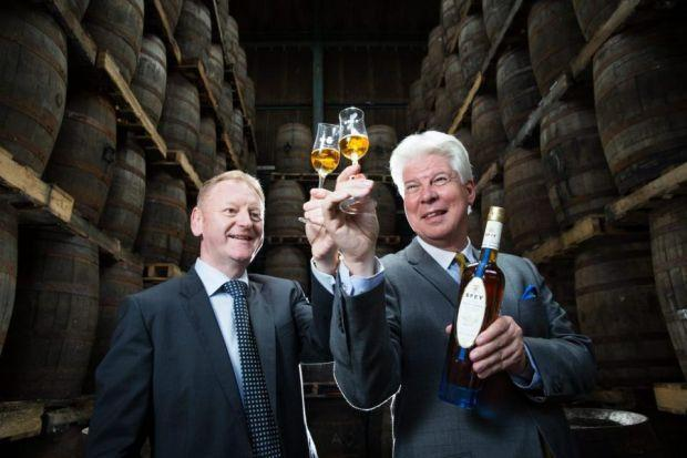 TOAST: Speyside director John McDonough (right) and Murdoch MacLennan from Clydesdale Bank raise a glass.