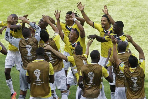 The Colombia squad perform an impromptu dance number as they celebrate Pablo Amero's early goal