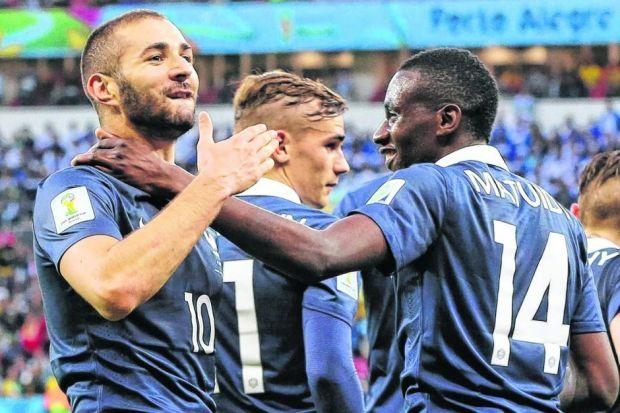 Karim Benzema celebrates with team mates after scoring his second 'official' goal last night. Picture: EPA