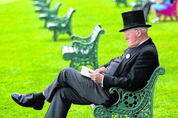 A racefoer studies form at Royal Ascot yesterday. Picture: Reuters