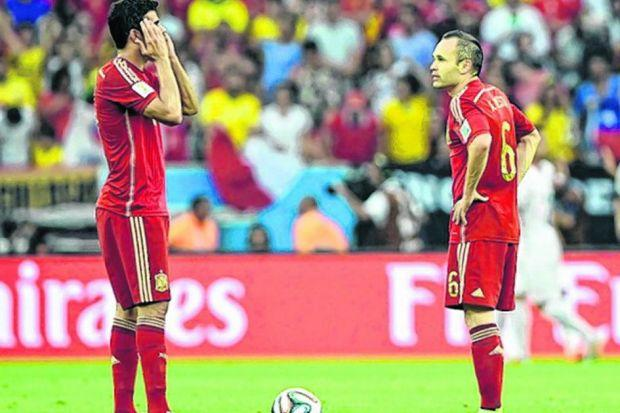 The reality of Spain's defeat sets in for Costa and Iniesta