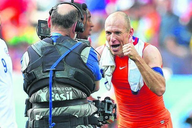 Arjen Robben celebrates after his side top Group B. Picture: Getty Sport