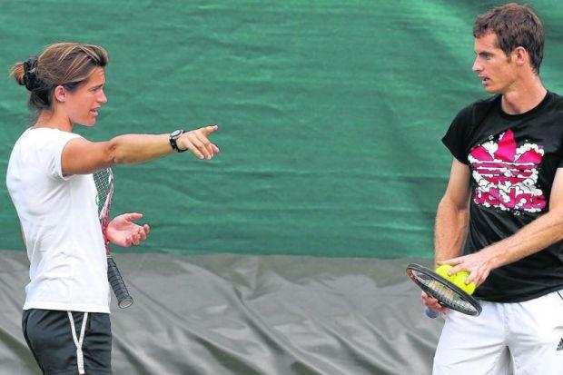 GIVING HIM A FEW POINTERS: Amelie Mauresmo puts Andy Murray thr