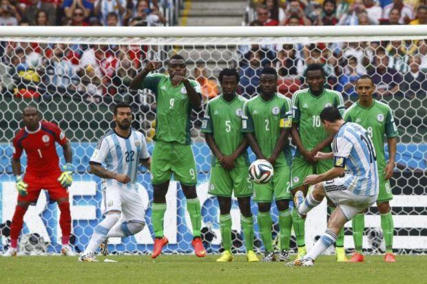 Members of Nigeria's defensive wall look frozen as Lionel Messi scores a sumptuous second goal yesterday in Porto Alegre. Picture: Fernando Vergara/PA