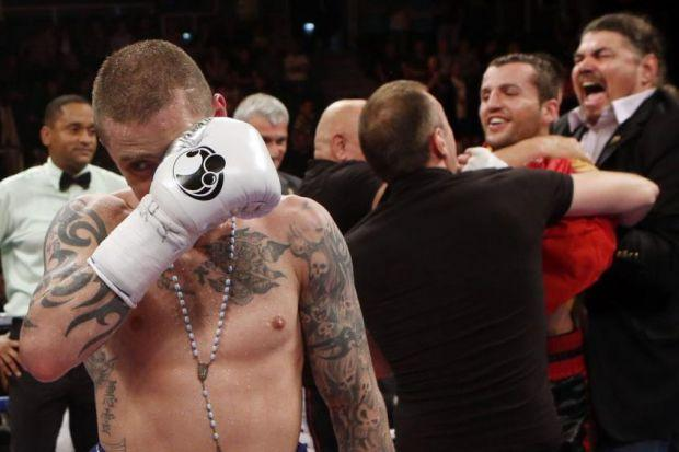 Ricky Burns is dejected after his defeat by Dejan Zlaticanin  Photograph: PA