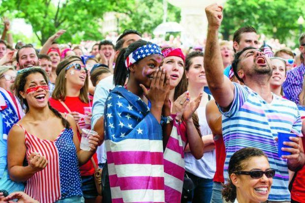 Crowds of USA fans watch their team's game against Germany on an outdoor screen in Washington D
