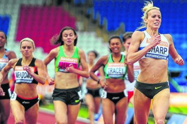 Lynsey Sharp crosses the line to win in Birmingham and regain the UK 800 metres title, with the Scot having to fend off a belated burst of pace from Alison Leonard. Picture: Dan Mullan/ Getty Sport