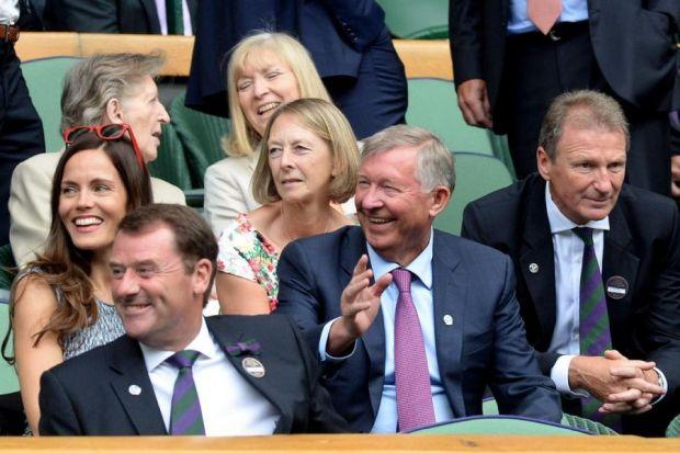 HAPPY: Sir Alex Ferguson preferred the Royal Box on centre court at Wimbledon to World Cup football action yesterday. Picture: Anthony Devlin