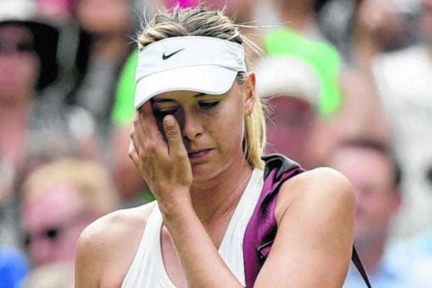 DEJECTED: Maria Sharapova bows her head after losing her fourth-round match in three sets against Angelique Kerber.  Picture: Al Bello/Getty Images
