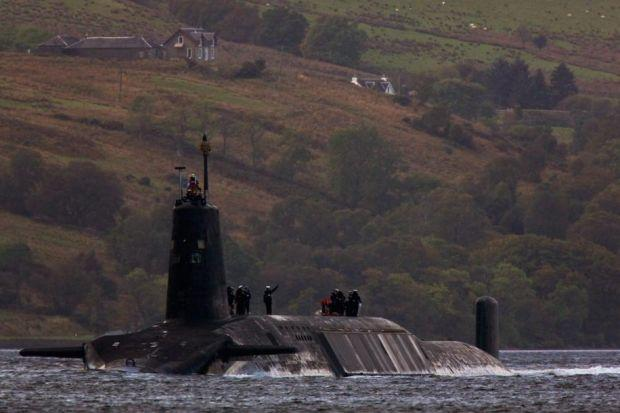 ON PATROL: The UK has four Vanguard-class submarines carrying Trident missiles. Each missile can deliver eight warheads against a dozen targets.