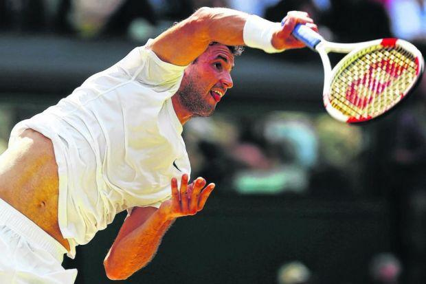 Gregor Dimitrov thumps down a serve en route to defeating Andy Murray. Picture: Getty