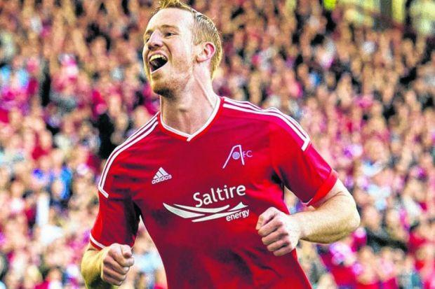 Adam Rooney scored twice and might have had more as Aberdeen cruised to victory. Picture: SNS