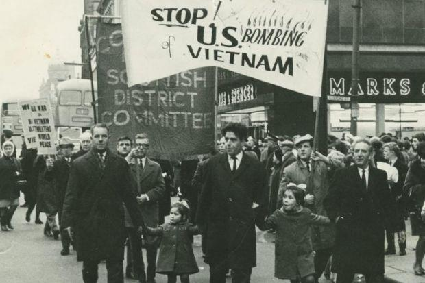 MAIN PHOTOGRAPH:Jimmy Reid, centre, with his young daughters Shona (on his right) and Eileen (on his left) on an anti-Vietnam War protest march in Glasgow in the 1960sFAR LEFTJimmy Reid with daughter  Eileen as a baby